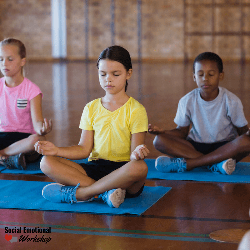 kids practicing yoga in school
